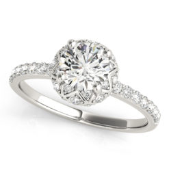 top view of a white gold diamond star-like halo engagement ring with a number of side and accent stones