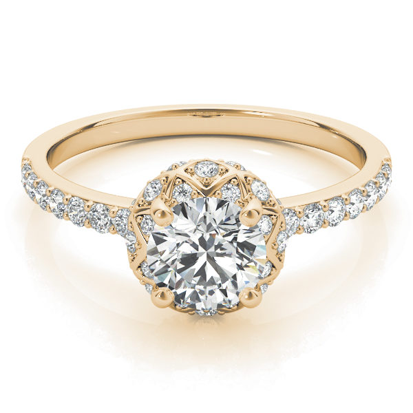 top view of a yellow gold diamond star-like halo engagement ring with a number of side and accent stones