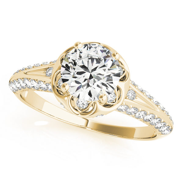 top view of a yellow gold diamond halo engagement ring with a number of side and accent stones