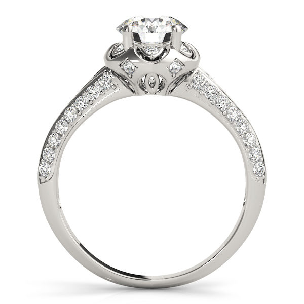 front view of a white gold diamond halo engagement ring with a number of side and accent stones