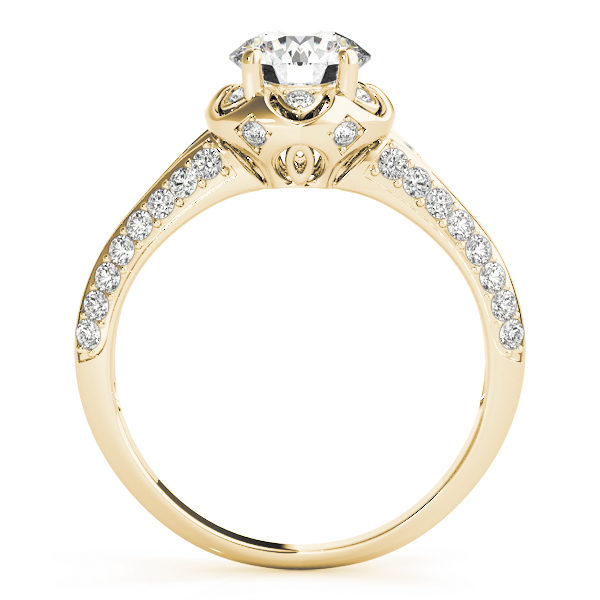 front view of a yellow gold diamond halo engagement ring with a number of side and accent stones