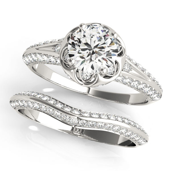 top view of a white gold diamond halo engagement ring and a plain one with a number of side and accent stones