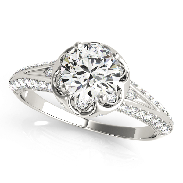 top view of a white gold diamond halo engagement ring with a number of side and accent stones