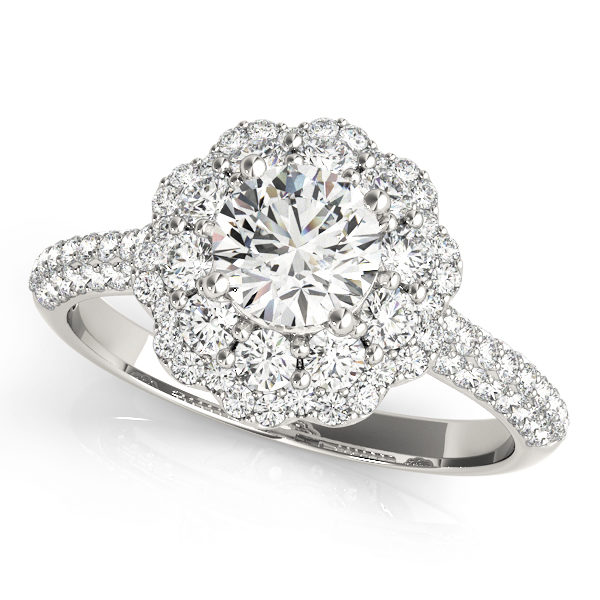 White gold halo pave diamond ring with side diamond accent formed as flower with row of diamonds embedded on upper shank