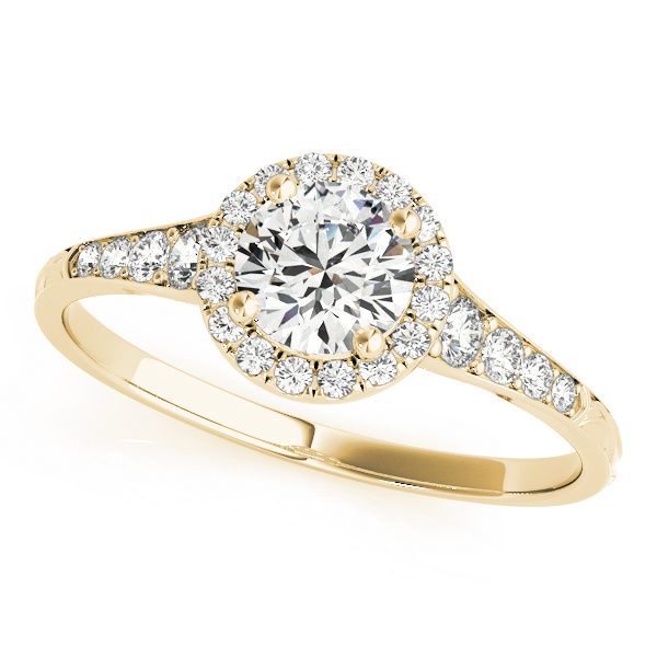 top view of a petite yellow gold diamond halo engagement ring