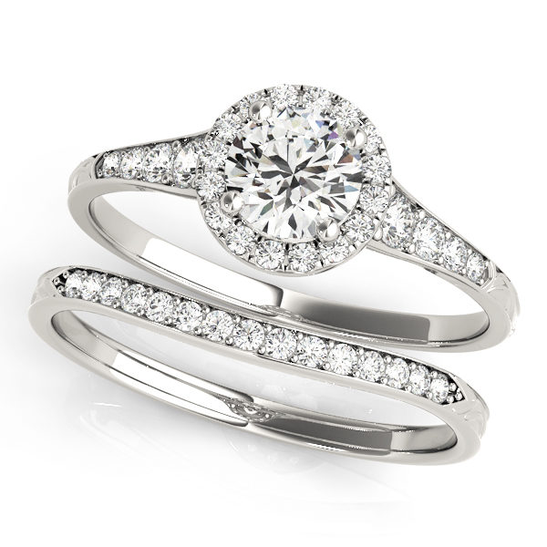 top view of two petite white gold diamond halo engagement rings, one has a head and one doesn't