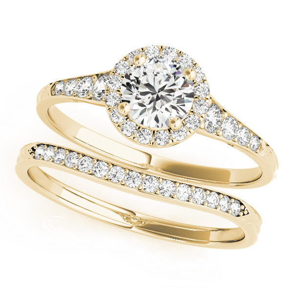 top view of two petite yellow gold diamond halo engagement rings, one has a head and one doesn't