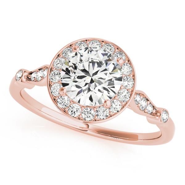 top view of a rose gold diamond halo engagement ring surrounded by smaller diamonds