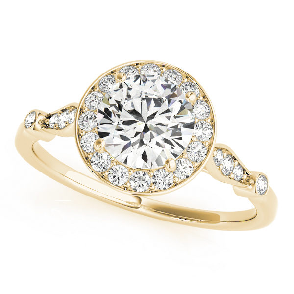 top view of a yellow gold diamond halo engagement ring surrounded by smaller diamonds