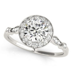 top view of a white gold diamond halo engagement ring surrounded by smaller diamonds