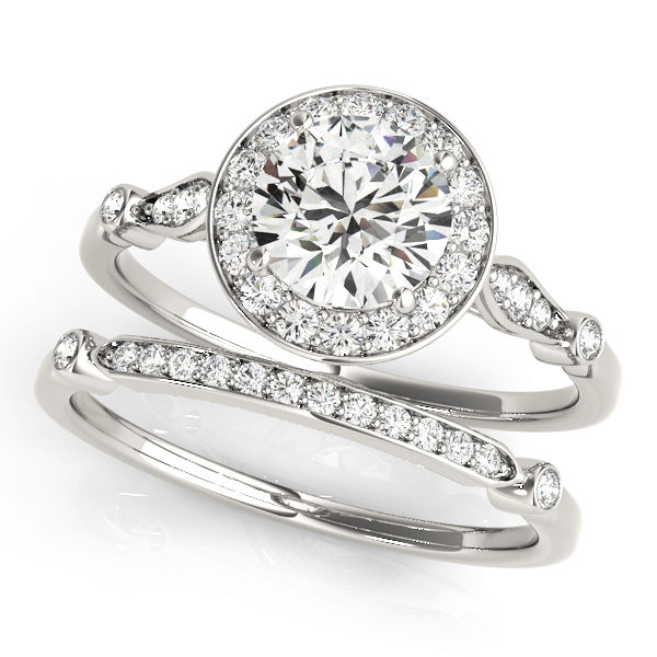 top view of two white gold diamond halo engagement rings, one has a head and one doesn't