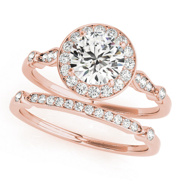 top view of two rose gold diamond halo engagement rings, one has a head and one doesn't