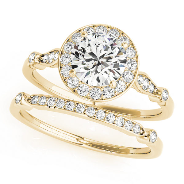 top view of two yellow gold diamond halo engagement rings, one has a head and one doesn't