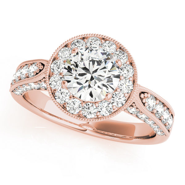 Rose gold round halo channel set engagement ring with milgrain designs surrounding the halo and upper shank