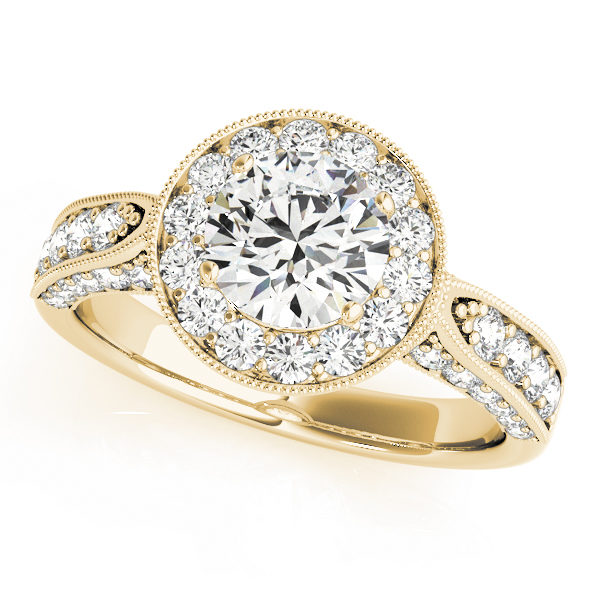 Yellow gold round halo channel set engagement ring with milgrain designs surrounding the halo and upper shank