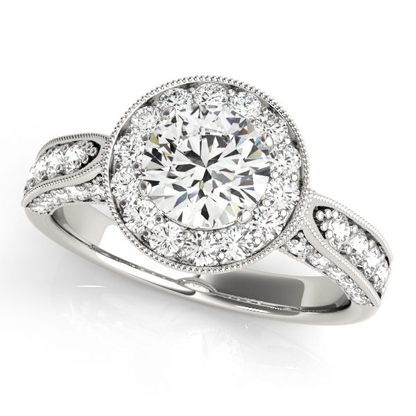 White gold round halo channel set engagement ring with milgrain designs surrounding the halo and upper shank