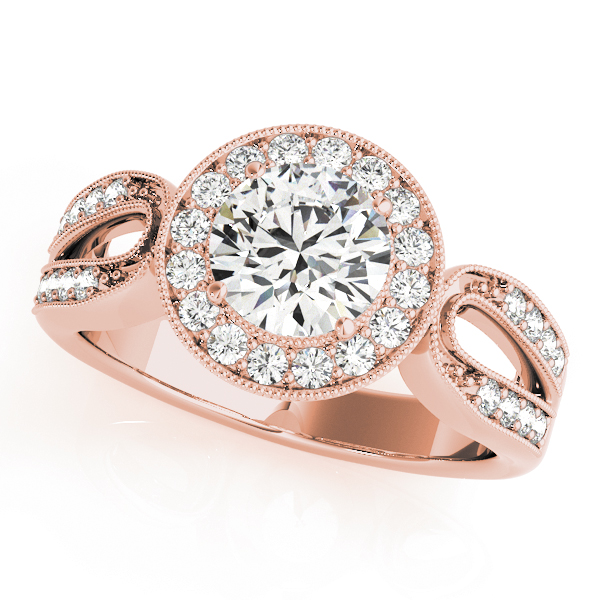 A rose gold halo engagement ring with a curved diamond double band shank.