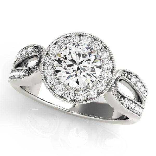 A white gold halo engagement ring with a curved diamond double band shank.