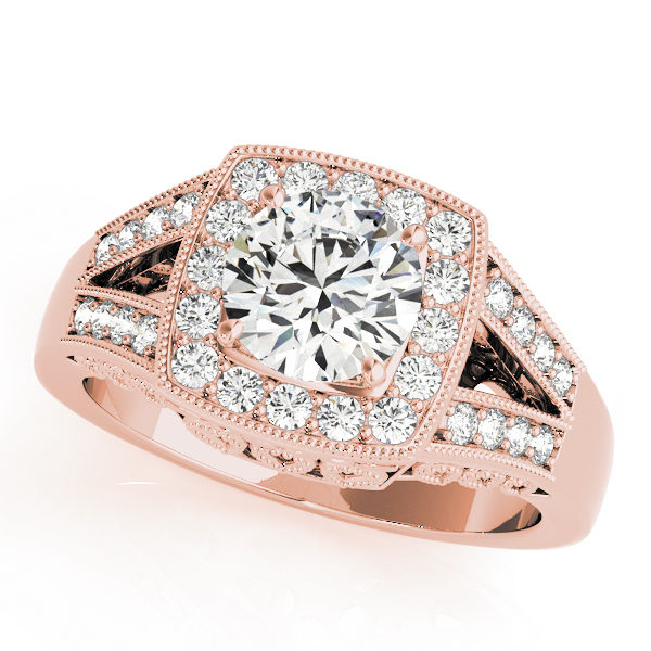 A rose gold engagement ring with a square halo diamond head, supported by two diamond set split shank.