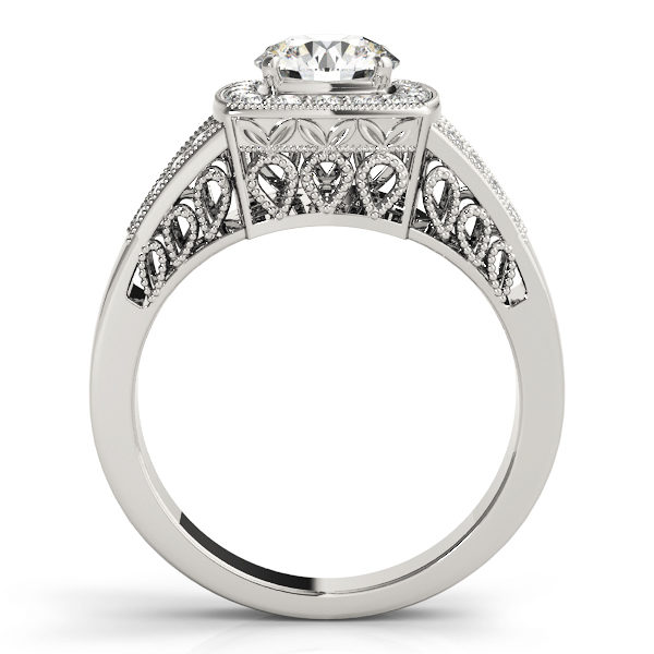 Side view of a white gold engagement ring with an water drop lattice style under gallery and upper shank.