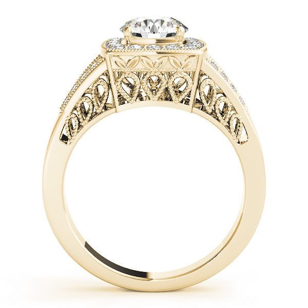 Side view of a yellow gold engagement ring with an water drop lattice style under gallery and upper shank.