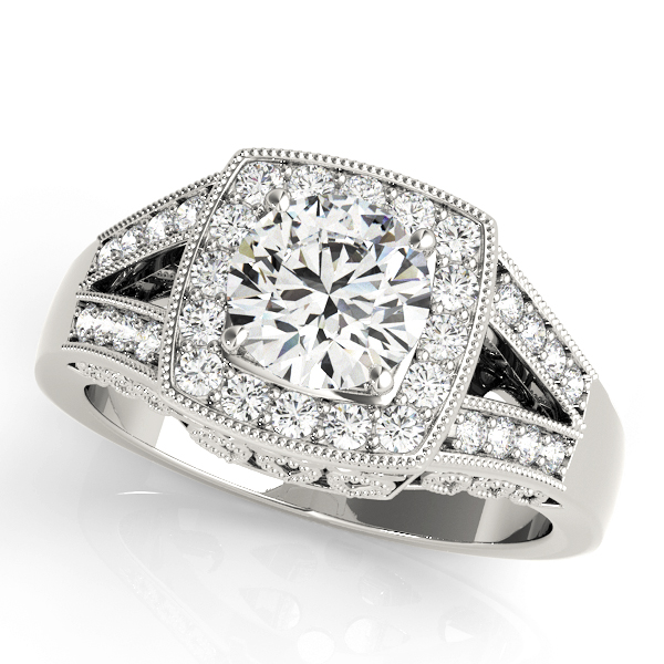 A white gold engagement ring with a square halo diamond head, supported by two diamond set split shank.