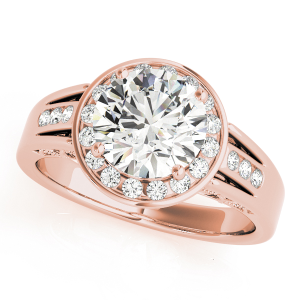 A rose gold engagement ring with a large diamond centerpiecem surrounded by a channel set halo, and a tri-band upper shank.