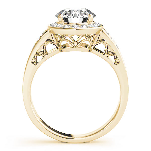 The side view of a yellow gold halo engagement ring with a curved style lattice undergallery and upper shank.