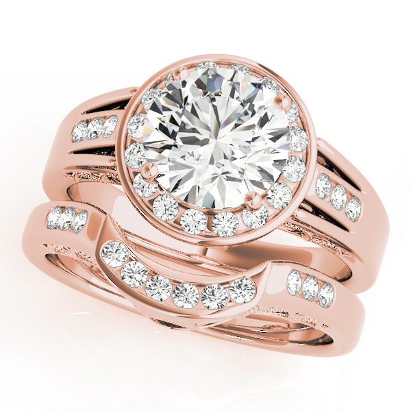 A rose gold wedding ring set comprised of a diamond halo engagement ring with a tri-band upper shank, and a curved channel set wedding band.
