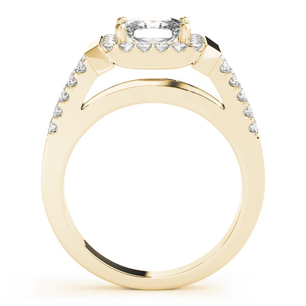 Side view of a yellow gold engagement ring with a surface prong set diamond embellished upper shank, and an open style under gallery.
