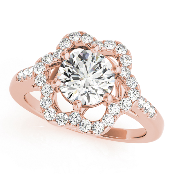 A rose gold engagement ring with a 6 prong flower halo set diamond head.