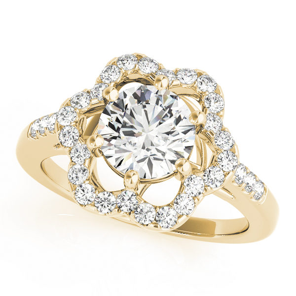 A yellow gold engagement ring with a 6 prong flower halo set diamond head.