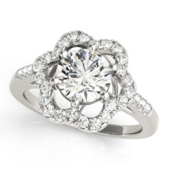 A white gold engagement ring with a 6 prong flower halo set diamond head.