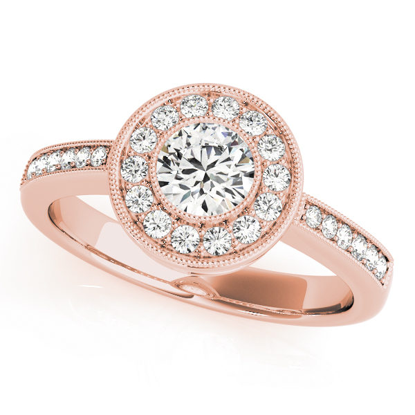 A single band rose gold engagement ring with a large round halo diamond head surrounded by prong set small diamonds.