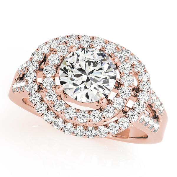 A 4 pronged triple curved halo diamond engagement ring in rose gold with a round cut stone on a surfaced setting embedded with melee diamonds.