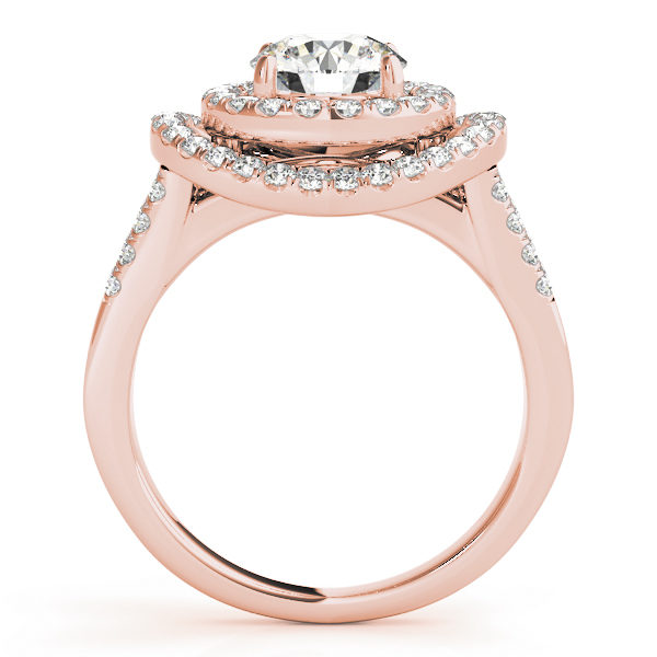 Side view of a curved halo diamond engagement ring in rose gold with a surfaced setting embedded with melee diamonds.