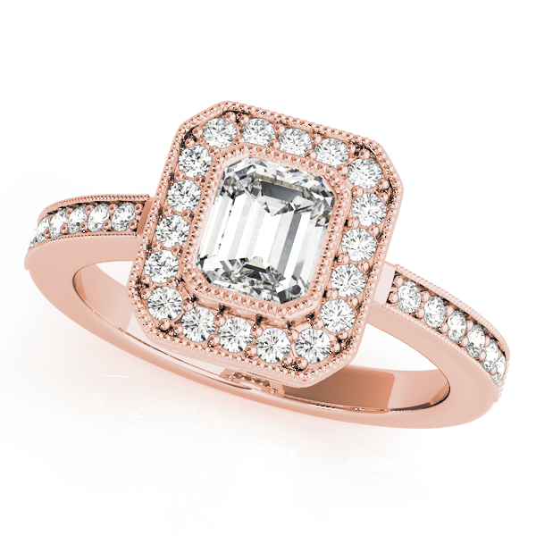 A halo diamond engagement ring in rose gold with an emerald cut stone on a pinpointed setting embedded with melee diamonds.
