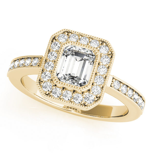 A halo diamond engagement ring in yellow gold with an emerald cut stone on a pinpointed setting embedded with melee diamonds.
