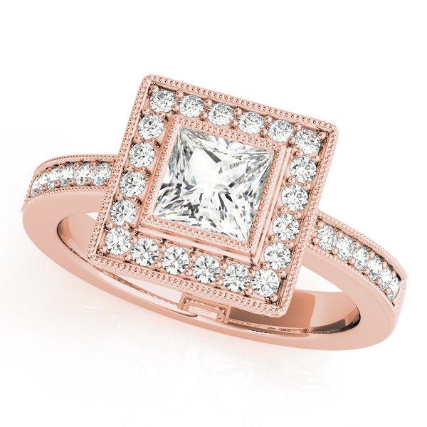 A halo diamond engagement ring in rose gold with a princess cut stone on a pinpointed setting embedded with melee diamonds.