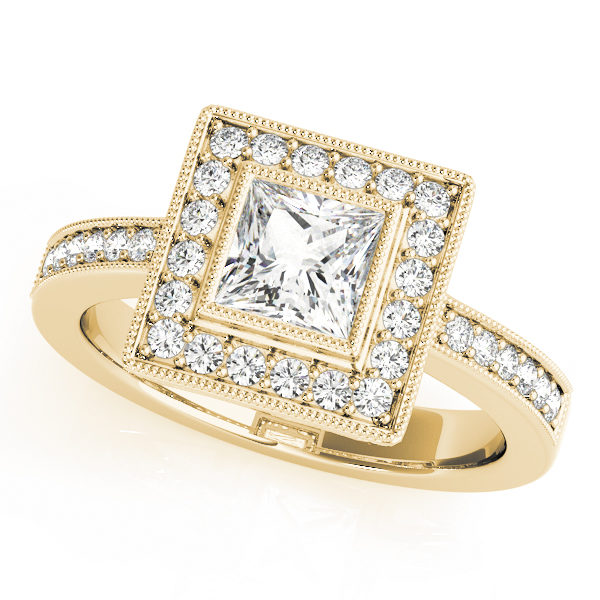A halo diamond engagement ring in yellow gold with a princess cut stone on a pinpointed setting embedded with melee diamonds.