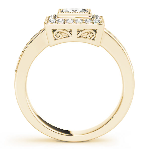 Side view of a traditional halo diamond engagement ring in yellow gold with an open cathedral on a channeled setting embedded with melee diamonds.
