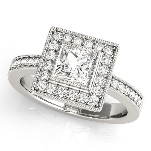 A halo diamond engagement ring in white gold with a princess cut stone on a pinpointed setting embedded with melee diamonds.