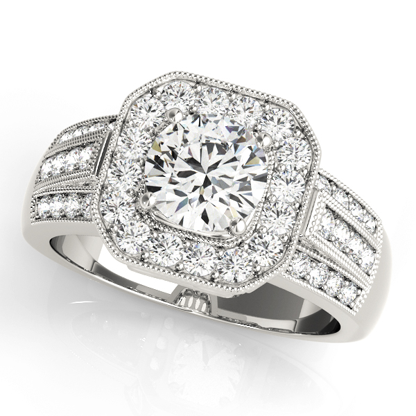 A 4 pronged halo diamond engagement ring in white gold with a channeled setting embedded with melee diamonds.
