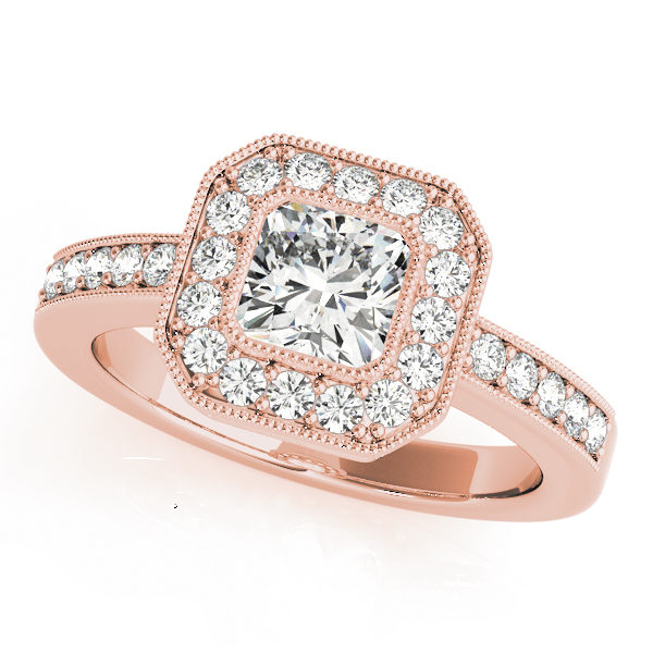 A halo diamond engagement ring in rose gold with a cushion cut stone on a channeled setting embedded with melee diamonds.