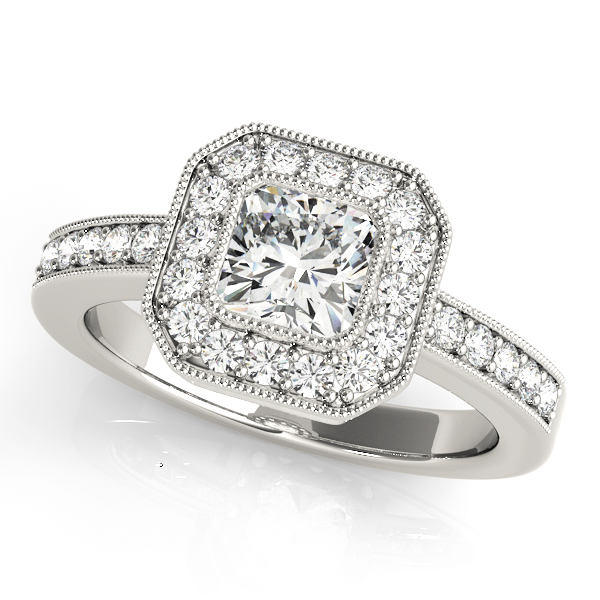 A halo diamond engagement ring in white gold with a cushion cut stone on a channeled setting embedded with melee diamonds.