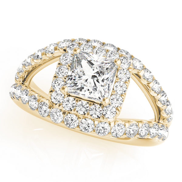 A 4 pronged halo diamond engagement ring in yellow gold with a princess cut stone with a split shank on a shared prong setting embedded with melee diamonds.