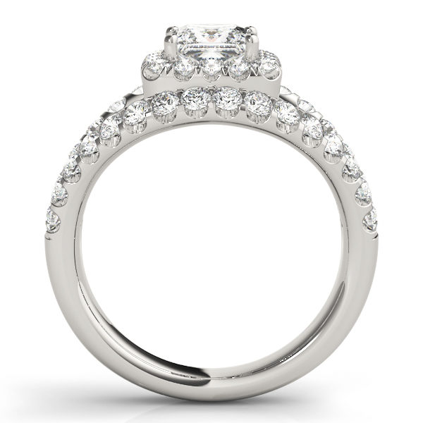 Side view of a halo diamond engagement ring in white gold embedded with melee diamonds on a surfaced setting.