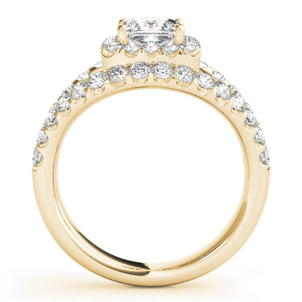 Side view of a halo diamond engagement ring in yellow gold embedded with melee diamonds on a surfaced setting.