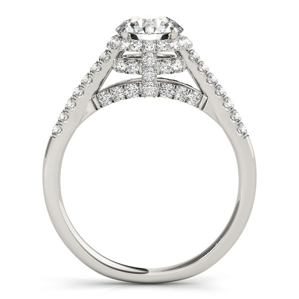 Side view of a halo diamond engagement ring in white gold with an open cathedral under gallery embedded with melee diamonds .