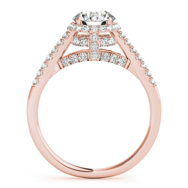 Side view of a halo diamond engagement ring in rose gold with an open cathedral under gallery embedded with melee diamonds .